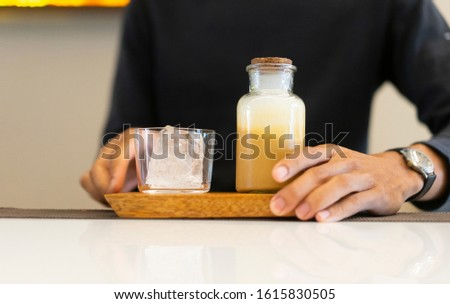 male barista making ice coffee  at cafe