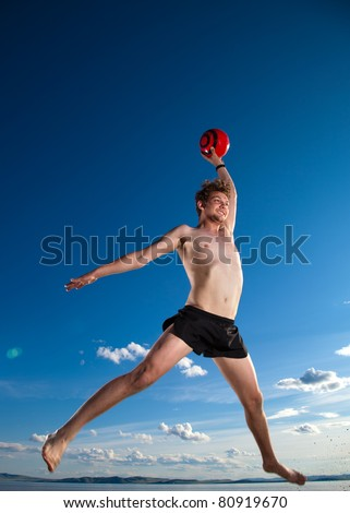male beach volleyball game player jump in blue sky