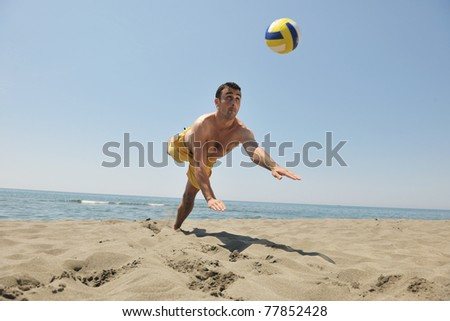 male beach volleyball game player jump on hot sand