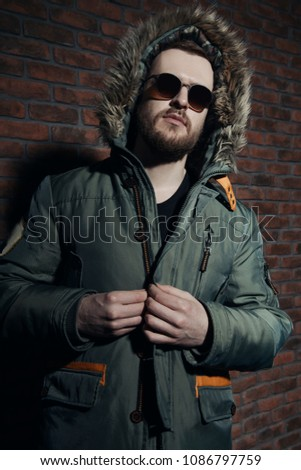 Portrait of brutal men in winter clothes  Images and Stock
