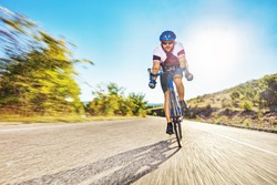 Male bicyclist riding on an open road