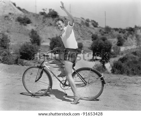 male bicyclist waving