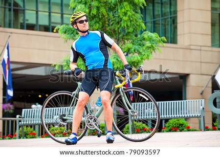 Male bike rider resting in downtown