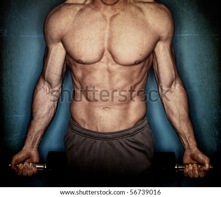 male body builder on textured background