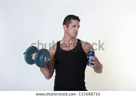 male bodybuilder not sure if he should have a drink of beer or carry on with his work out