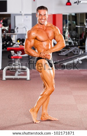 male bodybuilder posing in gym