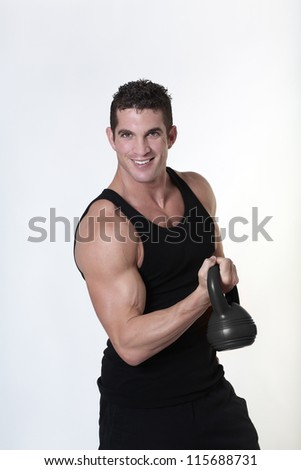 male bodybuilding doing a work out  lifting kettlebell