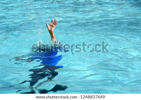 Male boy struggling underwater drowning in swimming pool. concept of safety