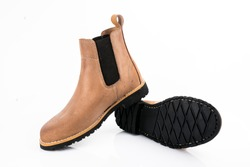 Male brown leather boots on white background, isolated product, comfortable footwear.