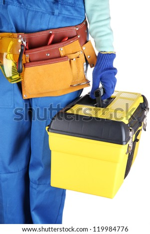 Male builder in blue overalls with yellow suitcase isolated on white