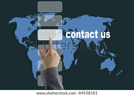 male business hand pushing on contact us button with world map background