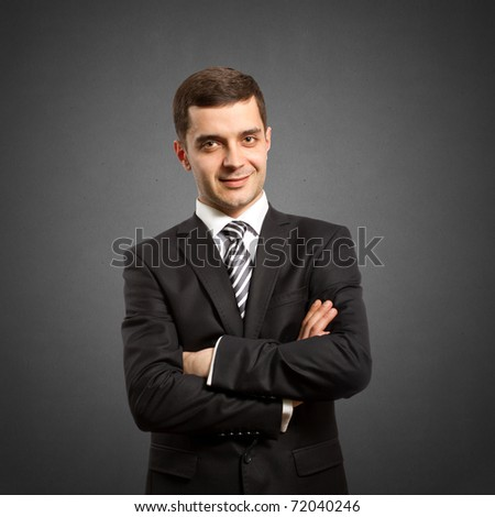 male businessman in suit with crossed hands, looking on camera