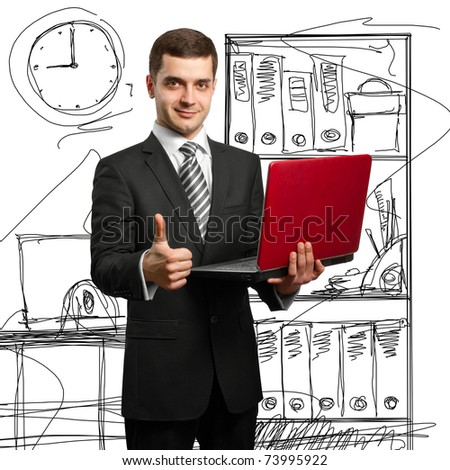 male businessman in suit with laptop in his hands, looking on camera