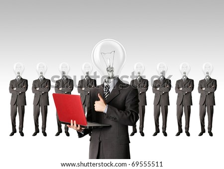 male businessman with lamp-head and laptop have got an idea