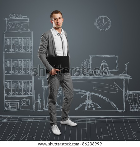 male businessman with laptop in his hands, looking on camera