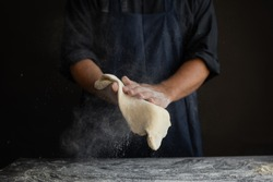 male chef hands toss pizza cake, cooking concept
