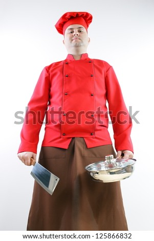 male chef in red and hat on a gray background