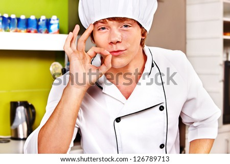 Male chef wearing uniform at cafeteria.
