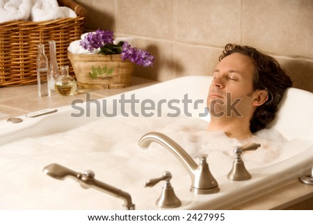 male client in an aroma bath at a spa