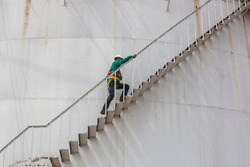 Male climb the stairway storage visual inspection tank