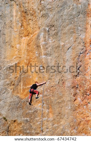 Male climber on a rock wall