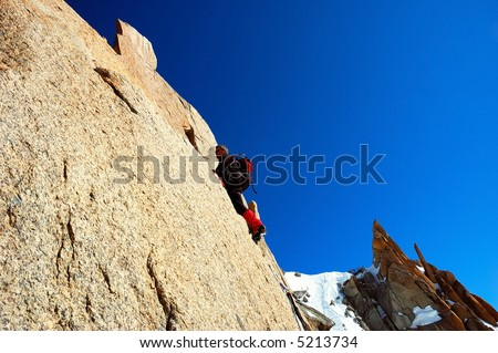 Male climber, Rock-climbing sport, horizontal orientation, day light; Mont Blanc massif
