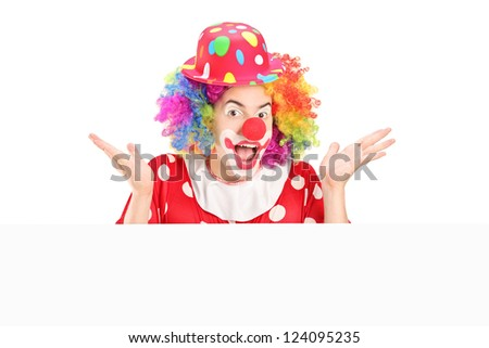 Male clown gesturing behind blank panel isolated on white background