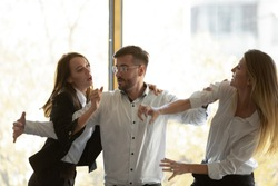 Male colleague set apart two envious jealous aggressive business women coworkers fighting at corporate office meeting, angry female rivals have bad relation competition conflict violence at workplace