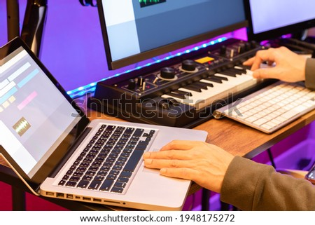 male composer, producer, arranger, song writer, musician hands arranging music on computer in home studio. music production concept ストックフォト ©
