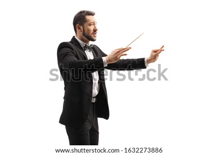 Male conductor in a suit conducting with a baton and gesturing with hand isolated on white background Foto stock ©