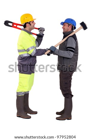 Male construction workers shaking hands