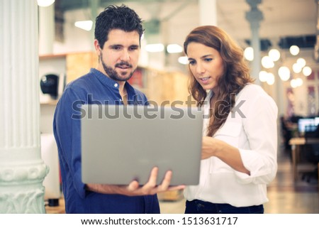 Male coworker asking a quick question to his colleague in a hipster coworking space.  #1513631717