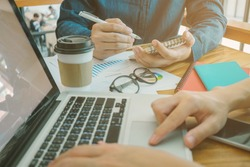 Male creative designer writing business plan at workplace