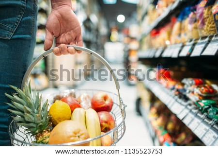 Male customer hand with basket, supermarket