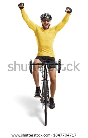 Male cyclist riding a road bicycle towards the camera and gesturing happiness isolated on white background Photo stock ©