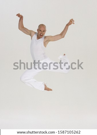 Male dancer leaping in mid-air