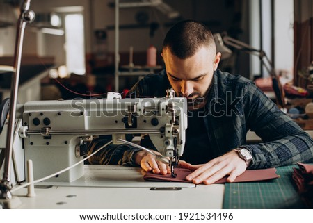 Male designer and leather tailor working at a factory Foto stock ©