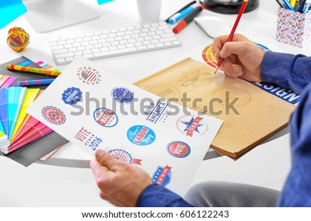 Male designer working in office #606122243