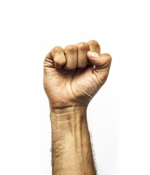 Male dirty fist hand closeup photo isolated on white background, proletarian protest symbol