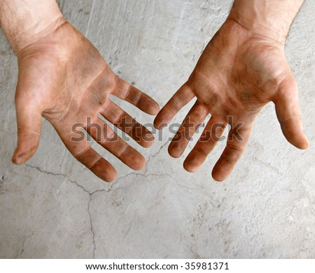 male dirty hands over gray concrete background