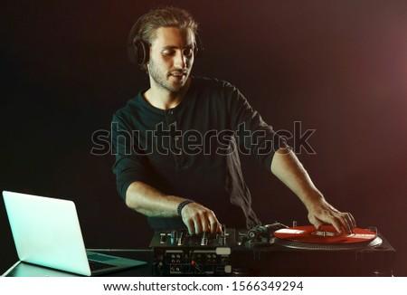 Male dj playing music in nightclub Сток-фото ©