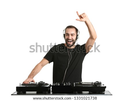 Male DJ playing music on white background stock photo