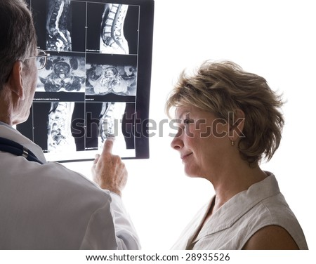 Male doctor and female patient discussing film scans of the patient's back.