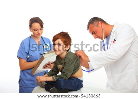 Male Doctor and  nurse examining a boy