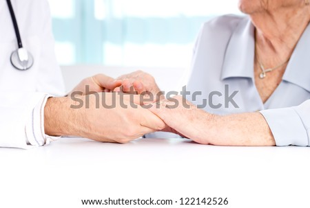 Male doctor discussing with his patient.