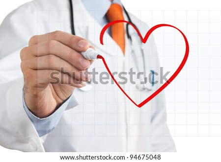 Male doctor drawing heart symbol at interactive whiteboard