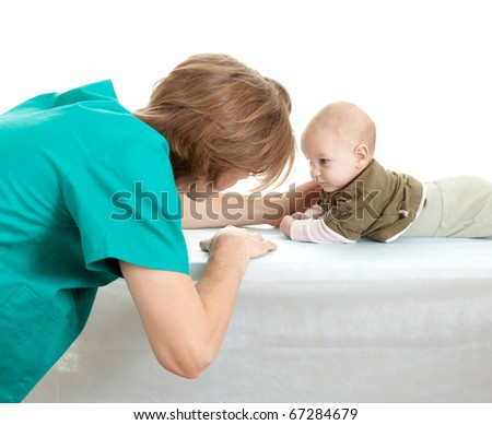 male doctor in green uniform examining baby boy