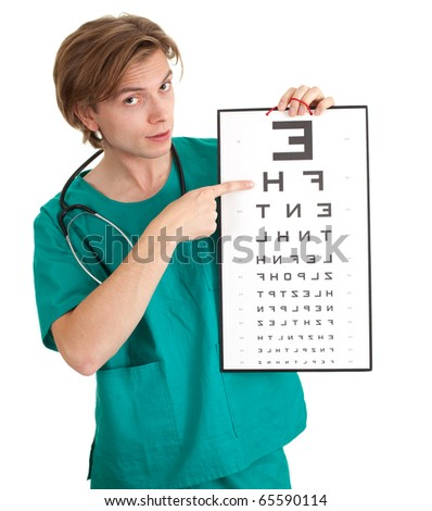 male doctor in green uniform with optometry chart