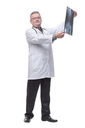Male doctor in white coat looking at x-ray. Concept of healthcare, roentgen, people and medicine