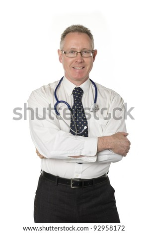 Male doctor isolated on white smiles directly at camera with arms crossed